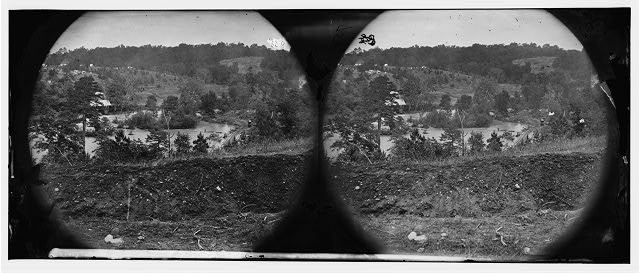 North Anna River, Virginia. View of log bridge at Quarles mill from south side. Camp of general headquarters in the distance
