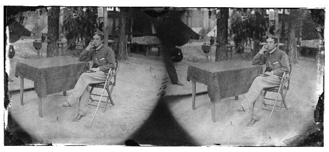 [Petersburg, Virginia]. Soldier seated at table