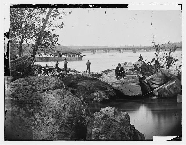 [Washington, D.C. Georgetown ferry-boat carrying wagons, and Aqueduct Bridge beyond, from rocks on Mason's Island]