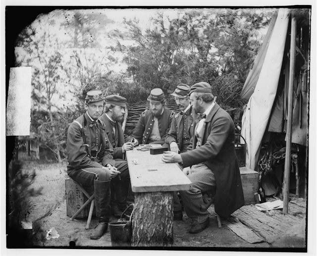 [Yorktown, Va., vicinity. Duc de Chartres, Comte de Paris, Prince de Joinville, and friends playing dominoes at a mess table, Camp Winfield Scott]