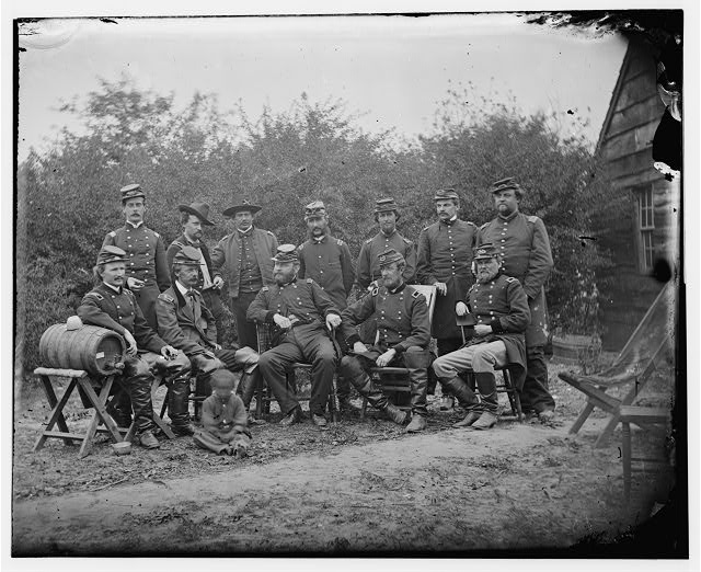 Cumberland Landing, Virginia. Seated: Generals, Andrew A. Humphreys, Henry Slocum, Wm. B. Franklin, Wm. F. Barry and John Newton. Officers standing not indentified