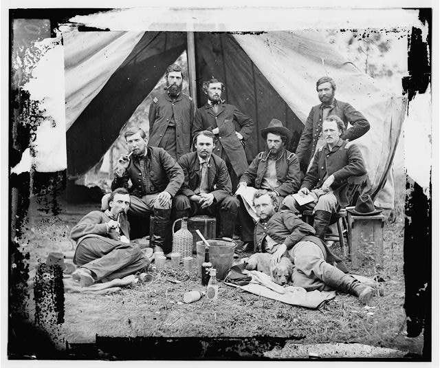 [The Peninsula, Va. The staff of Gen. Fitz-John Porter; Lts. William G. Jones and George A. Custer reclining]