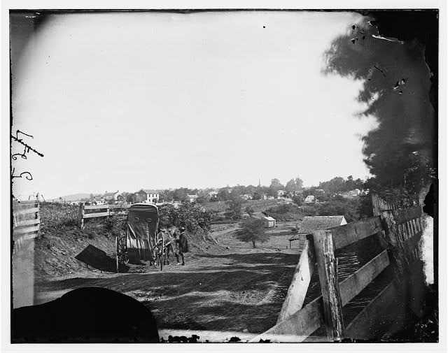 [Culpeper, Va. Approach to town, with photographer's wagon in foreground]