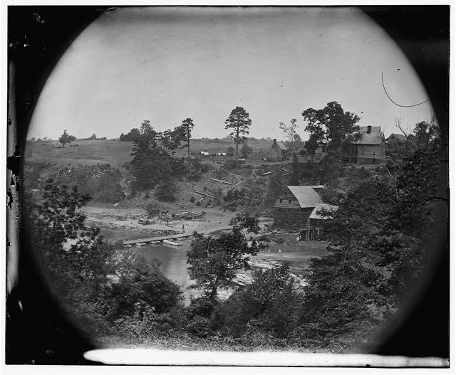 Jericho Mills, Virginia. Looking up North Anna river from south bank, canvas pontoon bridge and pontoon train on opposite bank, May 24, 1864