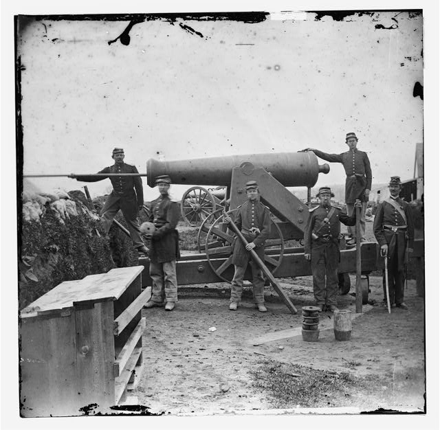 Arlington, Virginia. Soldiers of 4th New York heavy Artillery loading 24-pdr. siege gun on wooden barbette (Ingalls Battery? Fort Corcoran)