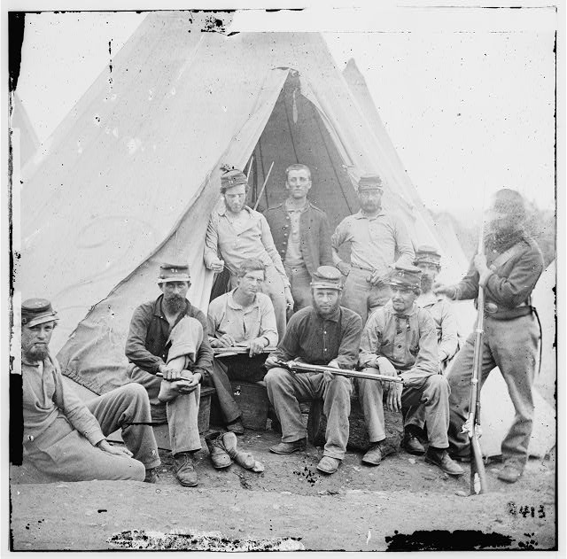 "Group of soldiers of Company G, 71st New York Vols. In front of 'Sibley"" tent"