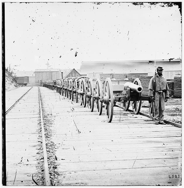 City Point, Virginia. Negro soldier guarding 12-pdr. Napoleon. (Model 1857?)