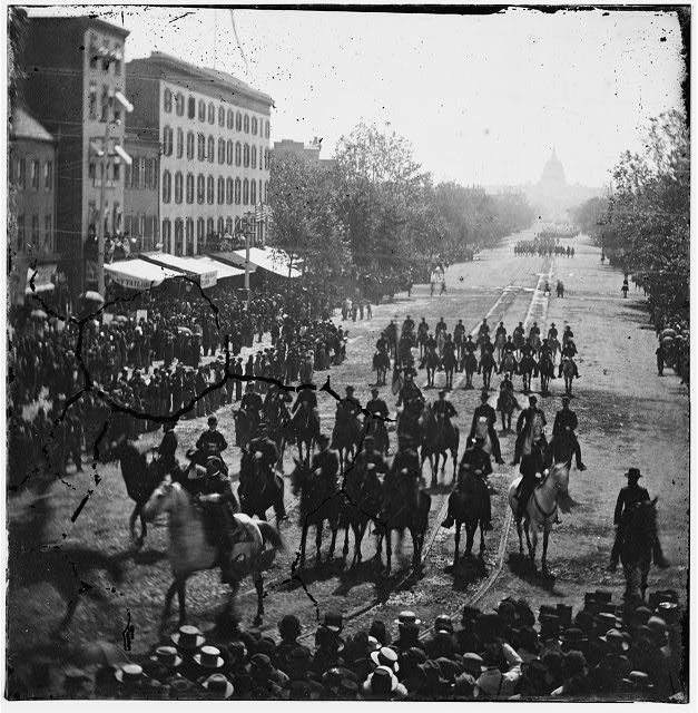Washington, District of Columbia. The Grand Review of the Army. [Cavalry?] passing on Pennsylvania Avenue near the Treasury