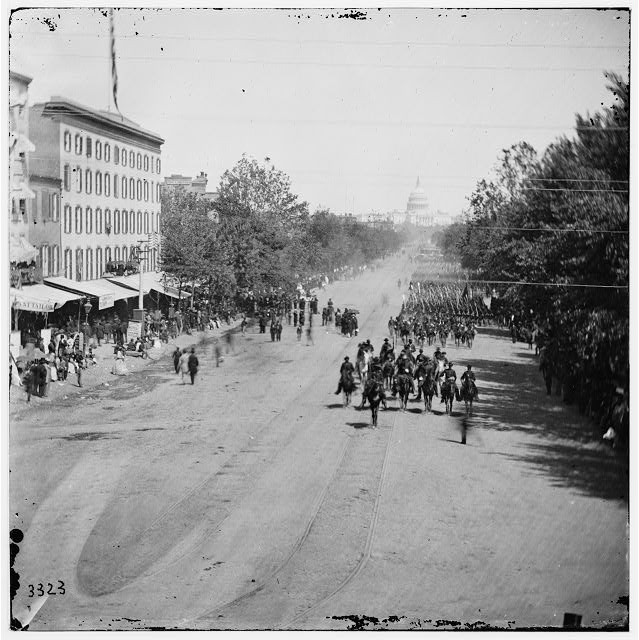 Washington, District of Columbia. Infantry passing on Pennsylvania Avenue near the Treasury