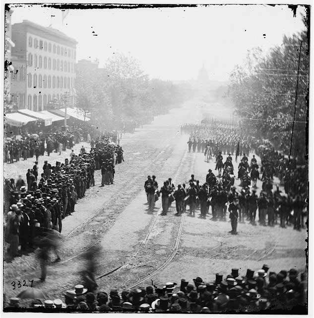 Washington, District of Columbia. Grand Review of the Army. Infantry passing on Pennsylvania Avenue near the Treasury