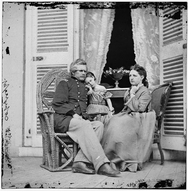 Richmond, Virginia. Gen. Edward O.C. Ord, wife and child at the residence of Jefferson Davis. In the doorway is the table on which the surrender of Gen. Robert E. Lee was signed