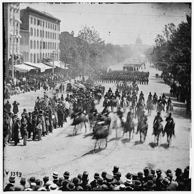 Washington, District of Columbia. The Grand Review of the Army. Gen. Henry W. Slocum (Army of Georgia) and staff passing on Pennsylvania Avenue near the Treasury