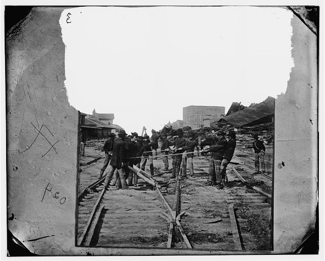 Atlanta, Georgia. Sherman's men tearing up railroad track