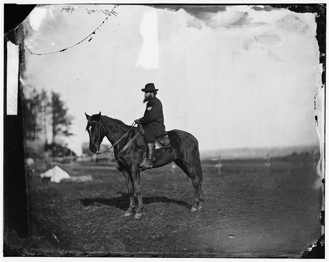 "[Brandy Station], [Virginia]. Alfred R. Waud, artist for ""Harper's Weekly"" (seated on a horse) at headquarters Army of the Potomac"