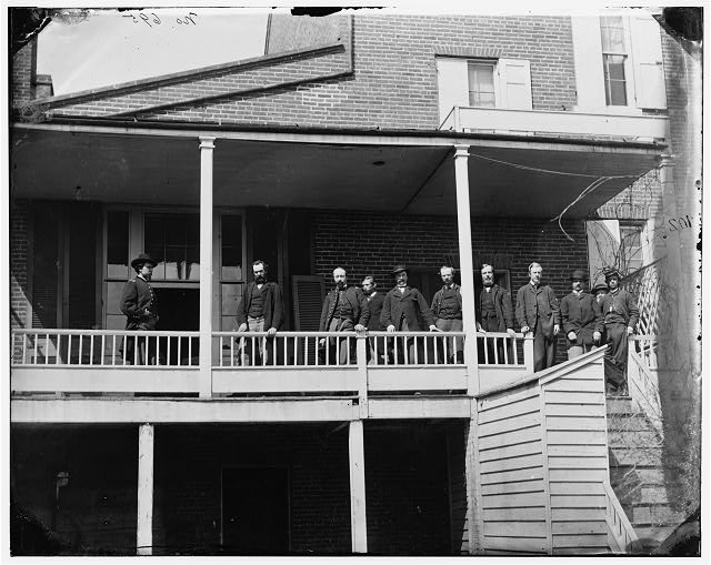 [Washington, D.C. Officers and clerks on a porch at Signal Corps headquarters]