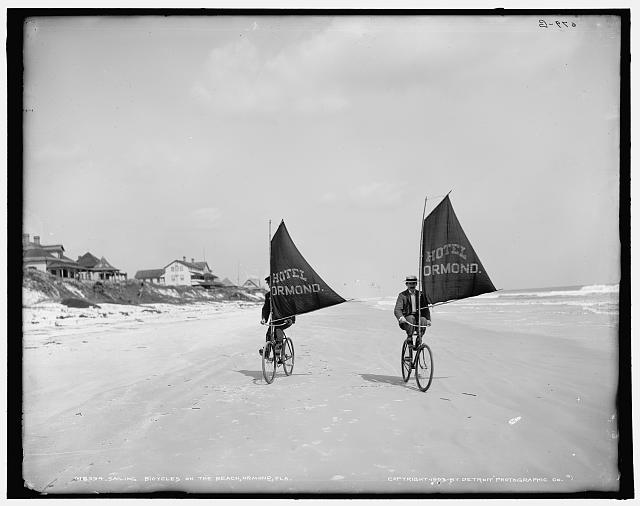 Sailing bicycles on the beach, Ormond, Fla.