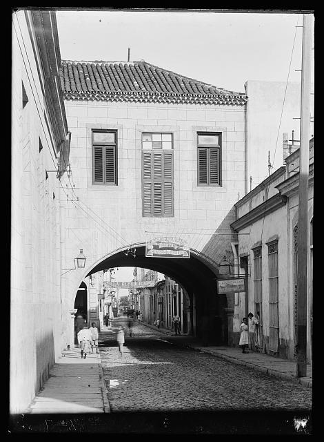 [Calle Acosta, alley with building arch, Havana, Cuba]