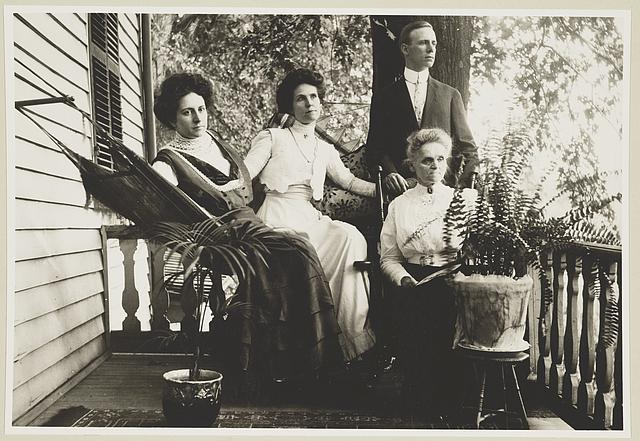 Three women and a man posed on a porch in Vienna, Va.