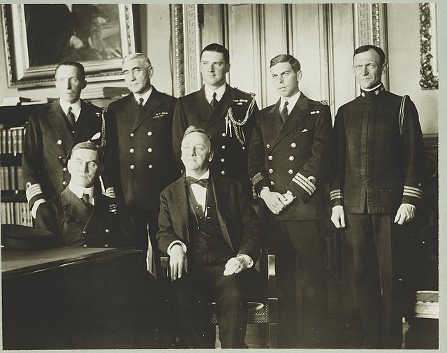 [Secretary of Navy Josephus Daniels (center) seated with Admiral [Trevylyan] Napier, R.N.; standing left to right: Capt. Blake of Naval Attache British Embassy, Admiral Long of U.S.N., Lt. Curzon-Howe, R.N., Com. Bevan, R.N., Com. Foote, U.S.N.]