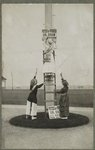 Suffrage campaign days in New Jersey (women putting up banner)