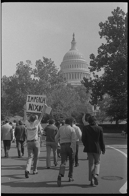 "[Demonstrators with ""Impeach Nixon"" sign near the U.S. Capitol, Washington, D.C.]"