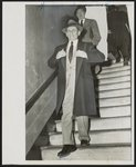 Sharply dressed, [gangster/gambler], Meyer Lansky as he left court today