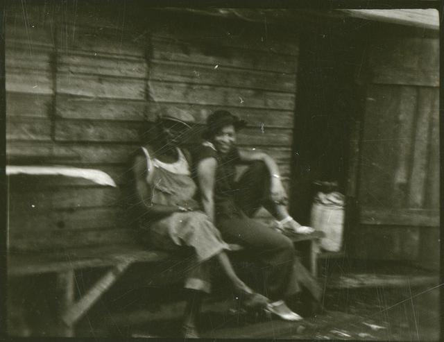 [Zora Neale Hurston and an unidentified man probably at a recording site, Belle Glade, Florida]