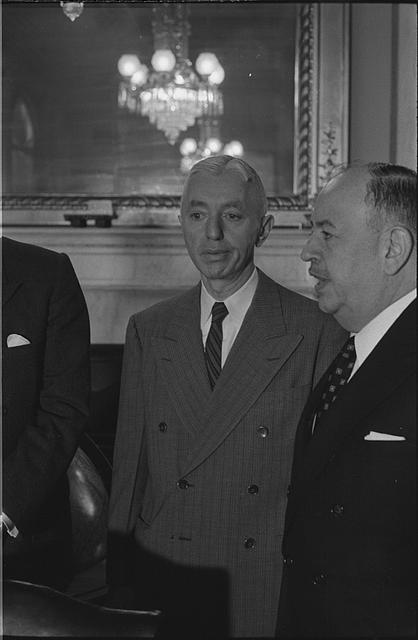 [Rear Admiral Hyman G. Rickover, standing in room, on the day of his testimony before the Senate Preparedness Subcommittee of the Committee on Armed Services]