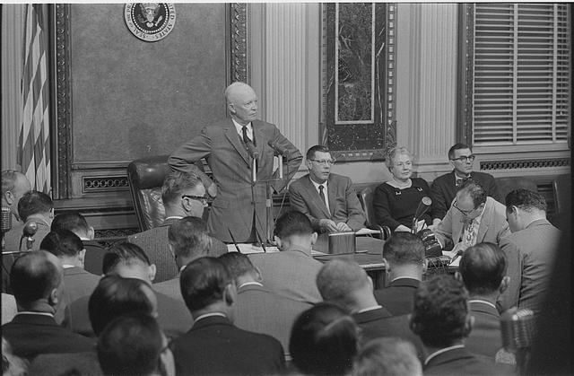 [President Dwight D. Eisenhower standing at a table at the White House, during a news conference at the White House, Washington, D.C.]