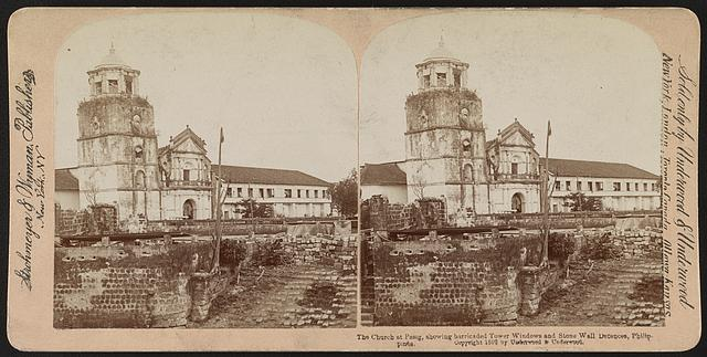 The church at Pasig, showing barricaded tower windows and stone wall defences, Philippines