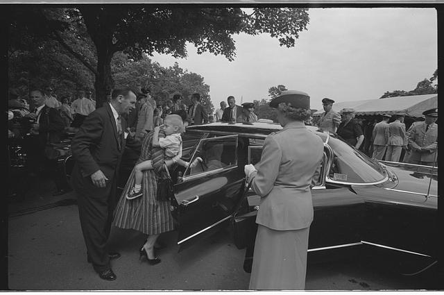 [Woman holding a child and getting into a car at the Arlington National Cemetery burial of Willard G. Palm, a RB-47 reconnaissance airplane pilot who was shot down by the Russians]