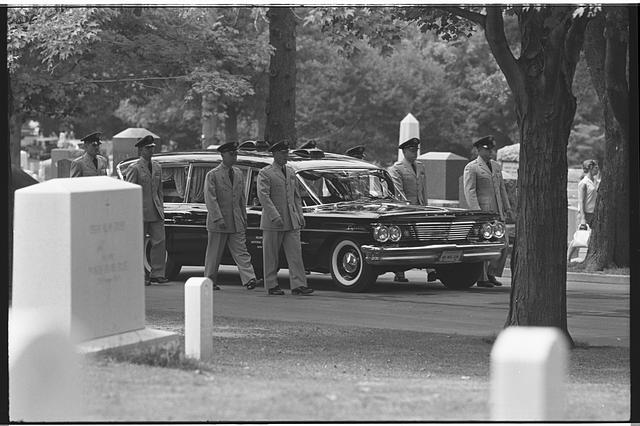 [Military personnel escorting a hearse, at the Arlington National Cemetery burial of Willard G. Palm, a RB-47 reconnaissance airplane pilot who was shot down by the Russians]