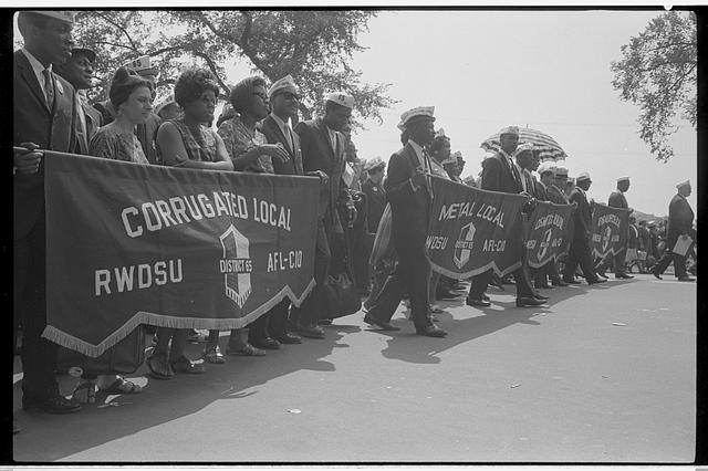 """[Marchers carrying labor union banners, including one reading """"Corrugated Local RWDSU District 65, AFL-CIO"""" during the March on Washington, 1963]"""