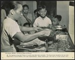 Colonial empire - introducing Malaya and Borneo. The Japanese armies left Malaya in a pitiful state after their surrender. The Government decided to set up a new Department of Social Welfare, with wide responsibilities. Needy children get a free meal at a Kuala Lumpur clinic