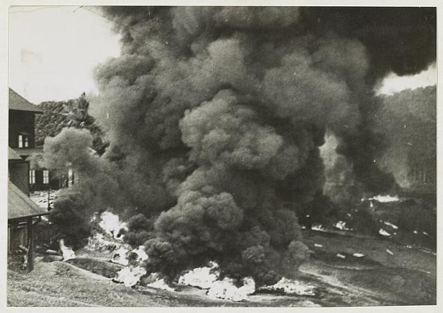 "Malaya - Britain pursues ""scorched earth"" policy ... British forces in Malaya have burnt thousands of bales of rubber, destroyed rubber factories and smashed machinery. Towering clouds of pungent smoke rise hundreds of feet in the air as a rubber factory is destroyed by the British forces."