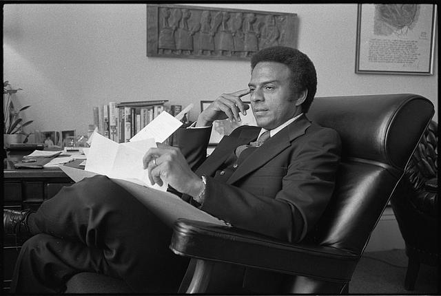 [Andrew Young, a Democratic Congressman from Georgia, three-quarter length portrait, seated, facing left]