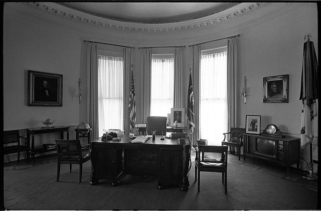 [Front view of desk and chair in the Oval Office in the White House, Washington, D.C.]
