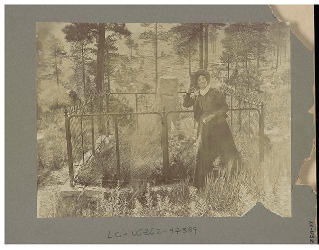 Calamity Jane on Wild Bill's grave