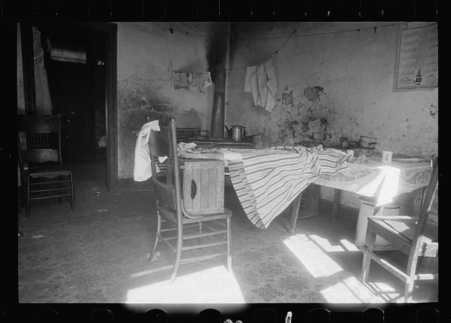 Kitchen of Negro dwelling in slum area near House office building, Washington, D.C.