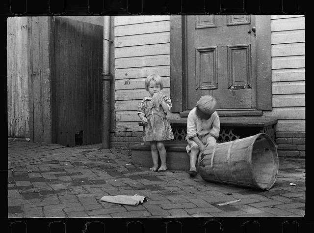 [Untitled photo, possibly related to: Poor children playing on sidewalk, Georgetown, Washington, D.C.]
