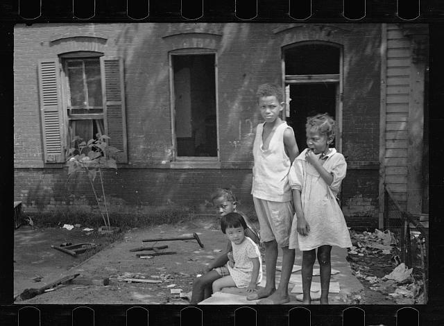 [Untitled photo, possibly related to: Slum front yard playground, Washington, D.C. Such is the front yard available to these two youngsters to play in]