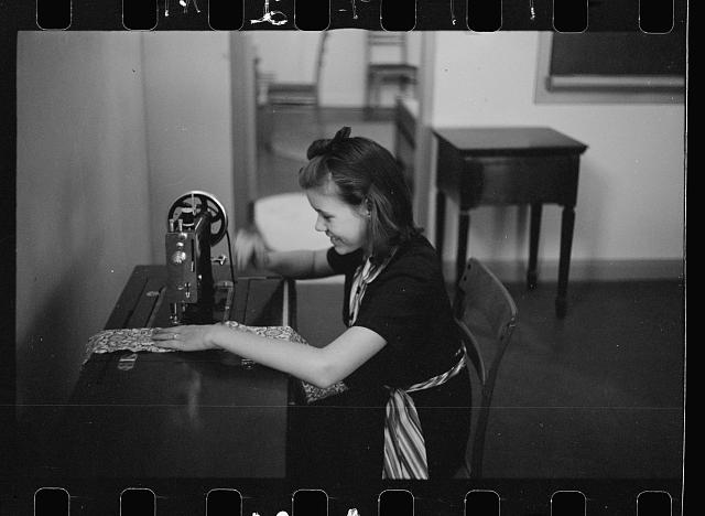 Girl sewing in home economics class, Greenhills, Ohio