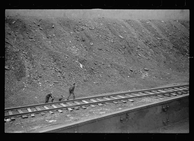 Miner's sons bringing home salvaged coal during May 1939 coal strike.  Kempton, West Virginia