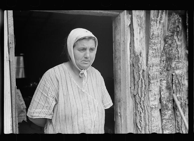 Mrs. Howard, who lives with her daughter in one-room cabin they built themselves, Aitkin County, Minnesota