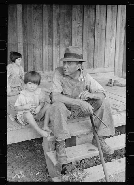 [Untitled photo, possibly related to: Sharecropper and children in front of company house. Wilson cotton plantation, Mississippi County, Arkansas]