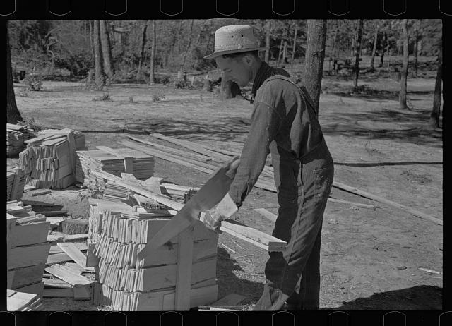 [Untitled photo, possibly related to: Cutting wood for shingles, Jackson County, Alabama]