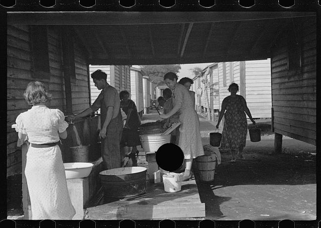 [Untitled photo, possibly related to: Source of water supply in the camp for migratory workers at Belle Glade, Florida]