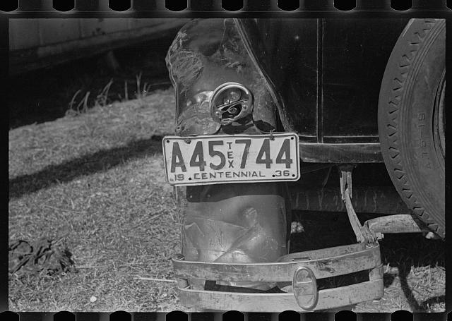 The battered rear of a migrant citrus worker's car. Winter Haven, Florida