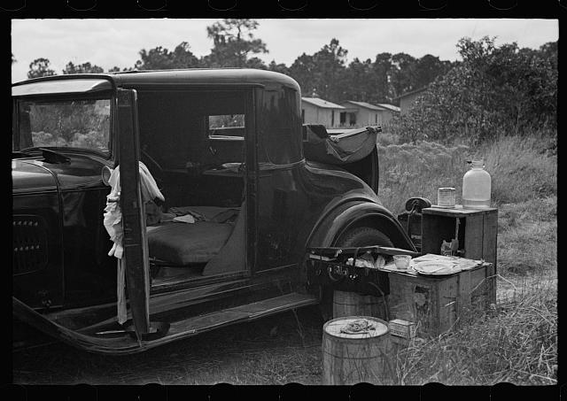 Car used by migrant agricultural workers; the rear has been fixed up as a bed, near Winter Haven, Florida
