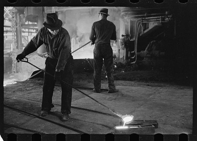 Pouring a test mold while blast furnace is being tapped, Pittsburgh, Pennsylvania